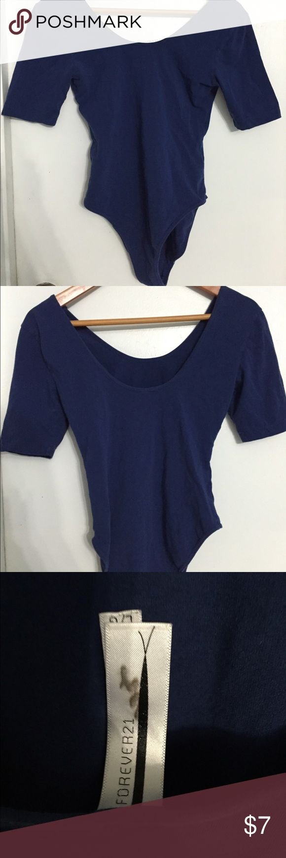 Forever 21 Dark Blue Bodysuit Leotard Basically new! Only used once for trying on. Feel like a ballerina in this dark blue bodysuit! Low Round Neck cut on front and back (back is a bit lower than front). Perfect for tucking into skirts or jeans! No stains, except for small printing stain on tag. Forever 21 Tops