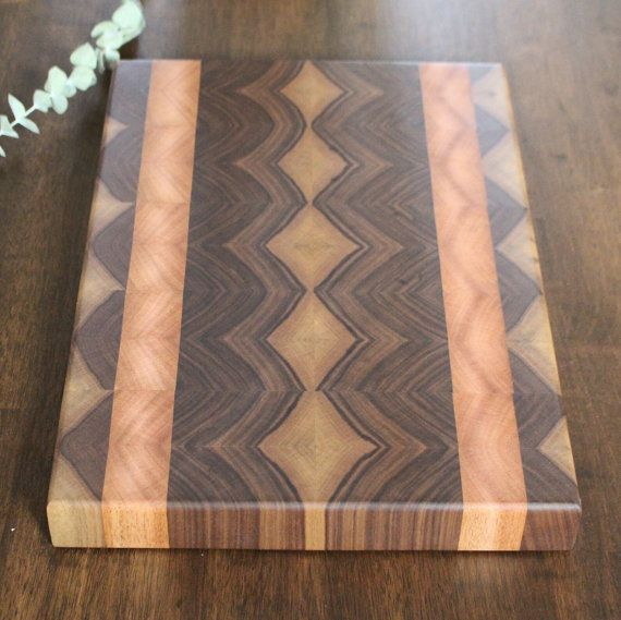 This is a beautiful end grain diamond design cutting board. These boards are carefully hand crafted and very unique.  This particulate board is made from walnut and mahogany.  Each board is finished with a bees wax / mineral oil combo and is ready for use.  This is like art in your kitchen.  It measures about 16.75 X 11.25 X 1. 5/8  This is 100% wood and lots of love went into making this particular board.
