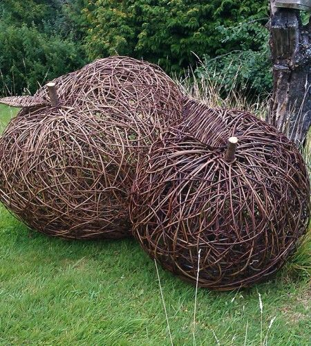 Giant Cider Apple Sculptures. These Apples were created to commission for a client from Kent. These sculptures by Willow Sculptor Victoria Westaway nestle under ancient fruit trees in an Orchard not far from the city of London.
