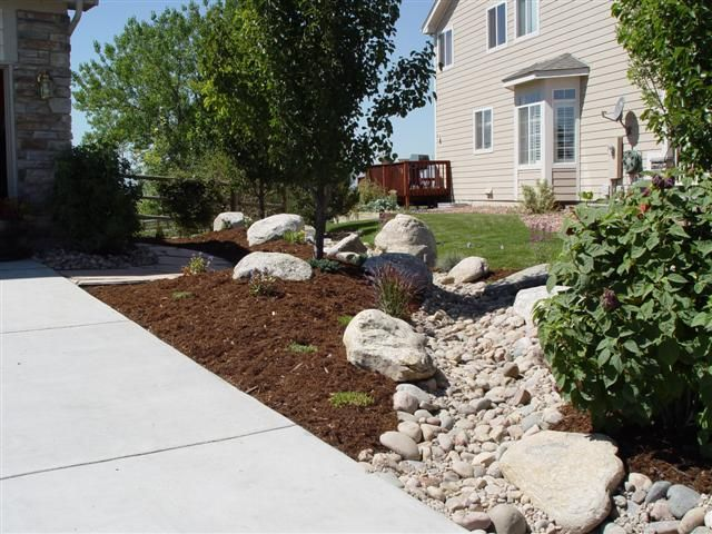 259 best images about dry creek river beds ideas on for River rock yard ideas