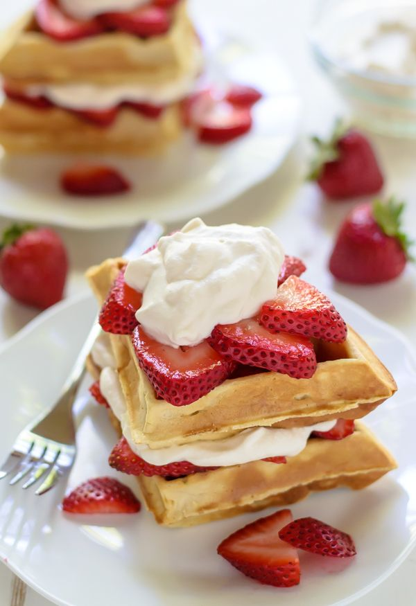 Put whole belgian waffle on a  plate, put vanilla ice cream on top, fresh strawberries all over, and then strawberry sauce drizzled over. Perfect for 4 people.