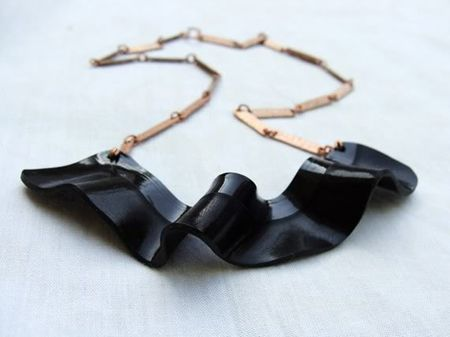 Vinyl Strip Necklace - I've got some ideas to make this really unique.  +Paper beads & gold leaf, etc.
