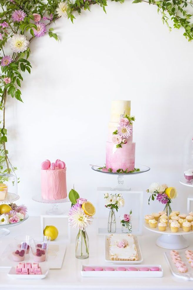 We can't think of a more fresh or unique theme for a summer dessert table than pink lemonade! Everything on this table looks sweet and fresh as can be.