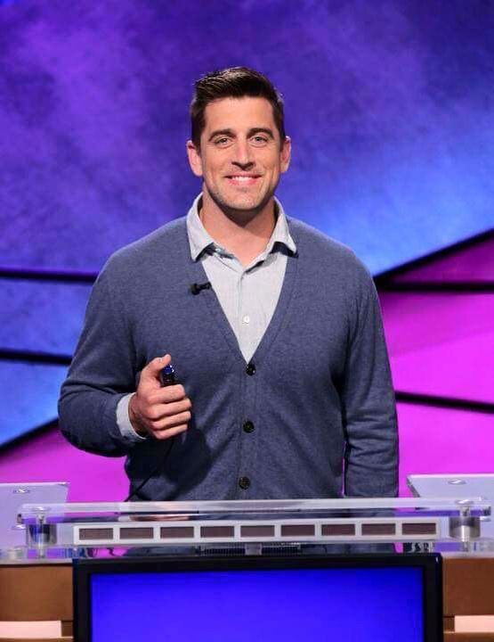 Jeopardy...Aaron Rodgers...He looks like such a nerd! Haha. Love the Mister Rodgers cardigan...Smart Guys are the Hottest Guys