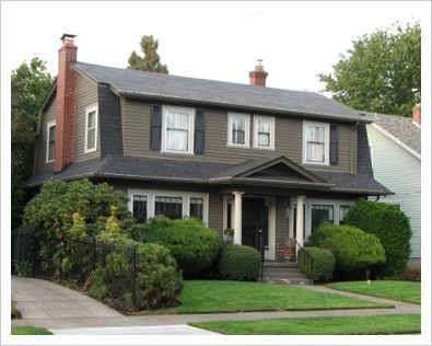 This style of home is called Dutch Colonial.  Our first home was this style.  I loved it so much and hope some day to own one again.