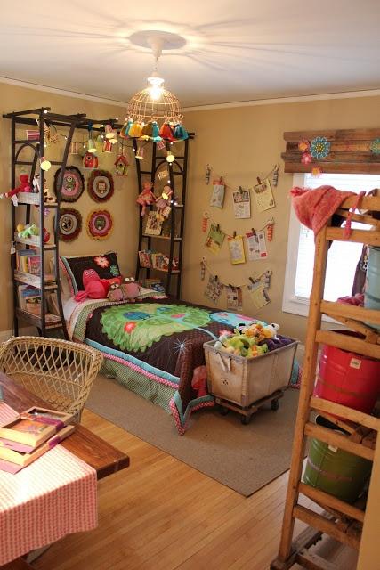 A garden trellis repurposed as a canopy / shelves / bedside tables.  Brilliant.