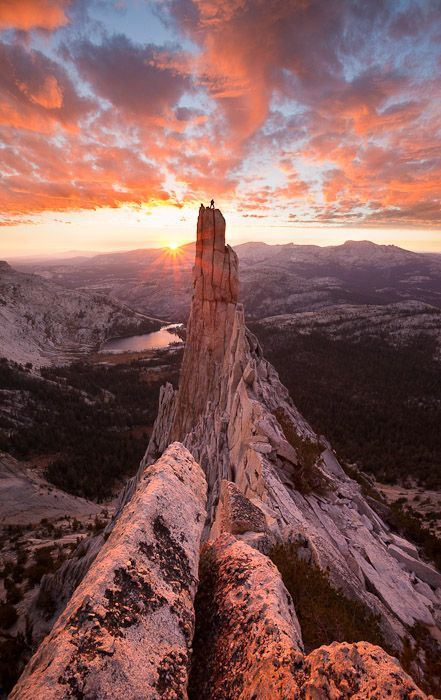A climber stands atop Eichorn Pinnacle in Yosemite National Park, California