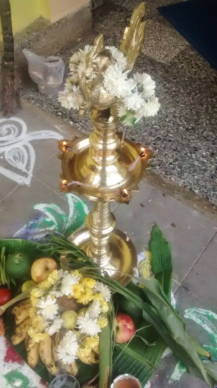 Lighted pongal kuthu velaku with fruits and flowers ................ http://myhomeevents.blogspot.in/2015/01/pongal-celebration-2015-pictures-in-my.html
