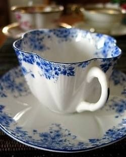 Teacup/saucer. I would LOVE to have tea the British way every morning with a full set of lovely china... ~ Leah