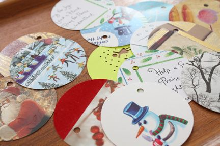 recycle.  cut out image from holiday card; hole punch; string through ribbon and now have a free gift tag for next year.