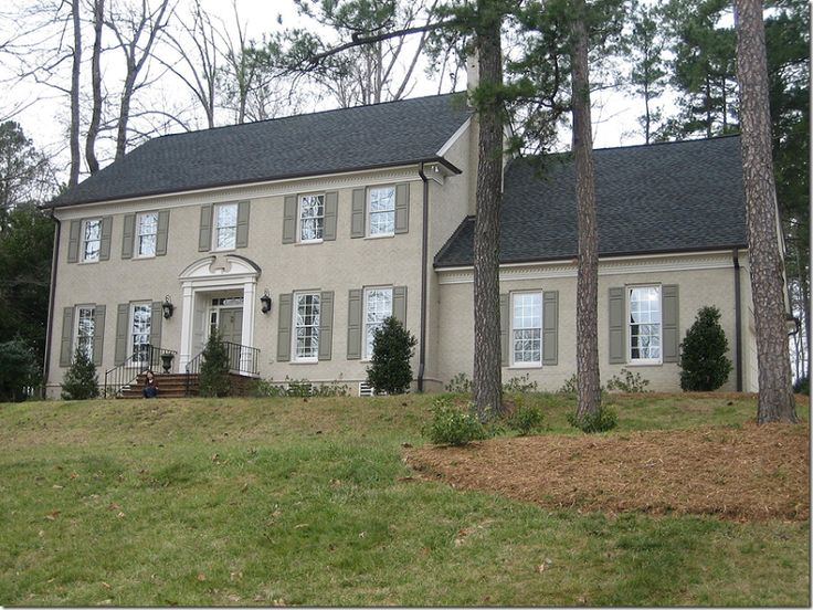 Painted taupe brick house with moss green shutters - Colonial house exterior renovation ideas ...