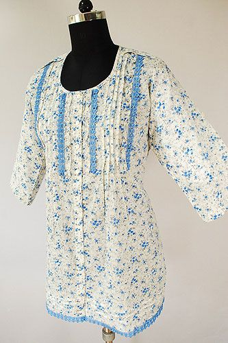 Cotton Tunic with floral print and blue laces make it an ideal summer wear.