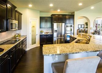Dark floors/cabinets, light counters.  Estates at Lochaven | New Indianapolis Homes For Sale | New Homes in Indianapolis | Beazer Homes