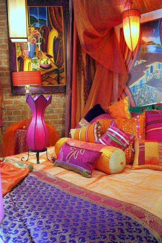 Colors are beautiful, but what is that magenta lamp on the bed doing?