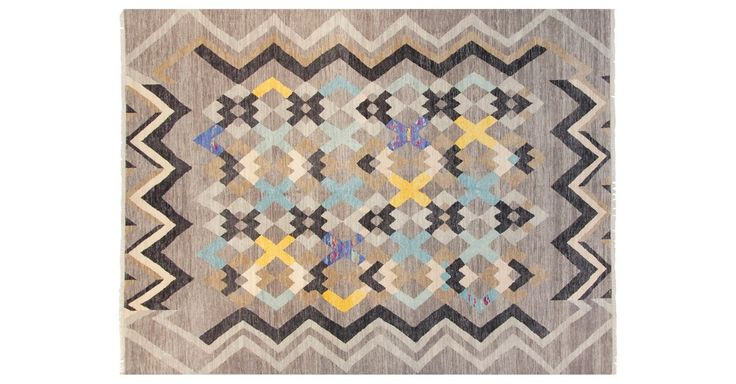 This stunning traditional rug was masterfully handmade of plush wool in India. Because each is meticulously knotted by hand, no two are alike. A rug pad is recommended to keep this rug securely in...
