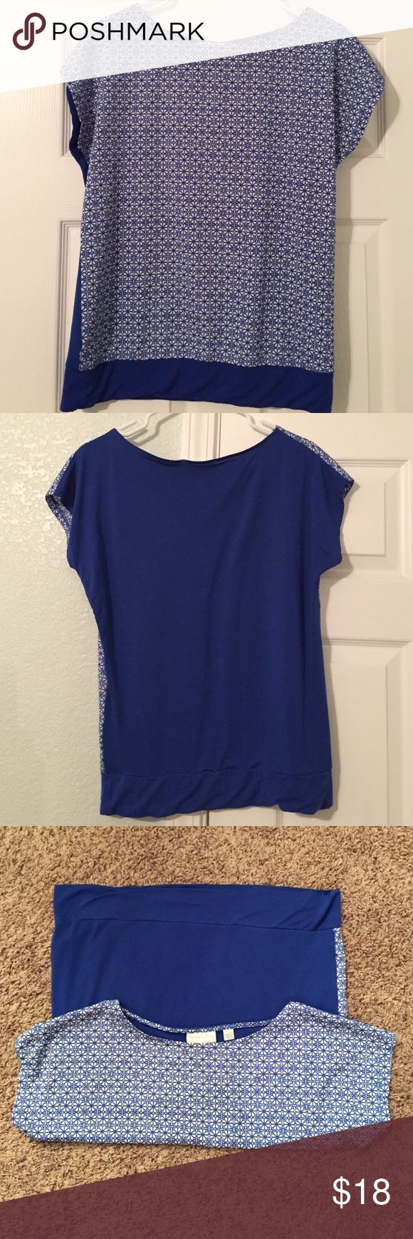 Fun and dressy women's top!! Blue and white women's top that can go with both casual and dressy looks. The front is polyester and has a fun design while the back is a rayon/spandex mix and is a solid blue. The color is beautiful! Great condition!! New York & Company Tops Blouses