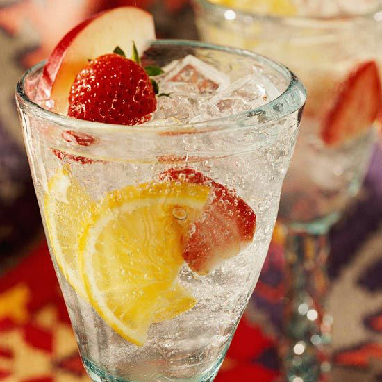 White Wine Sangria.  White wine and lemon-lime soda combine with fresh strawberries, oranges, and apple to create a refreshing summer cocktail.