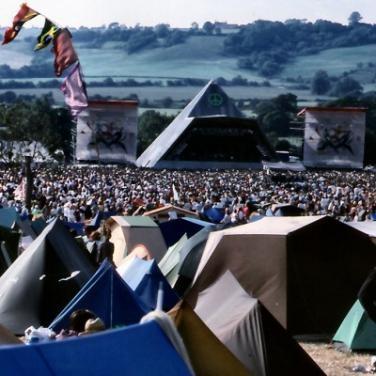 Glastonbury Festival in Somerset, England. Rock in the mud.