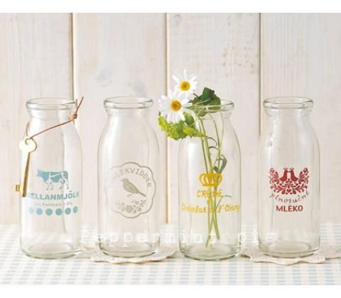 pretty vintage milk bottles - I actually use to drink milk from glass bottles that were delivered to our doorstep