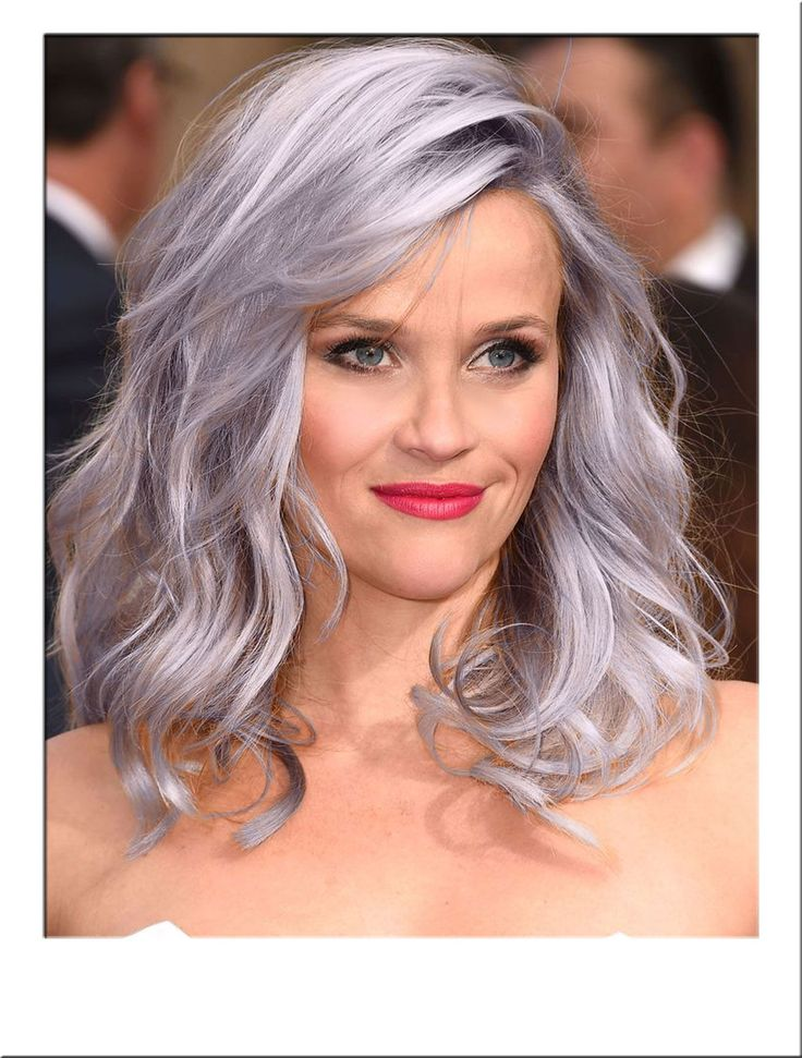 Silver Mid Length Wavy Wig. Gorgeous layered hair falls into waves and curly hair length ends. The side swept bangs originate from a side parting, flattering the face beautifully. Our fashion wig is fully heat resistant, allowing for straightening and curling the hair into an array of styles. Click the image for more information.