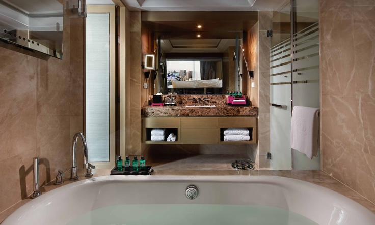 Opera Suite - large marble bathrooms with a separate tub, jacuzzi and shower & a selection of Hermès products. Very fast internet and espresso on the house #PinOfTheDay
