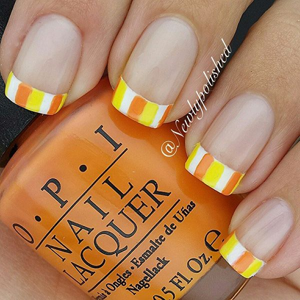 Brightly colored yellow, orange and white French tips. Give your French tips life with this bright and summer inspired ensemble arranged in stripes.