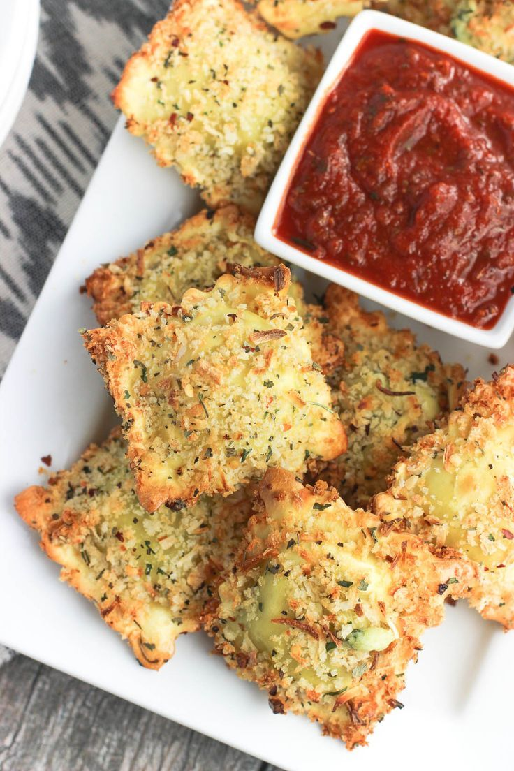 Entertaining & party appetizer recipe - This easy recipe for crispy and baked toasted ravioli will be a new appetizer favorite! Ravioli is coated in egg and an Italian-spiced panko breadcrumb mixture and baked for a crisp dish that's made healthier! Serve with marinara sauce.