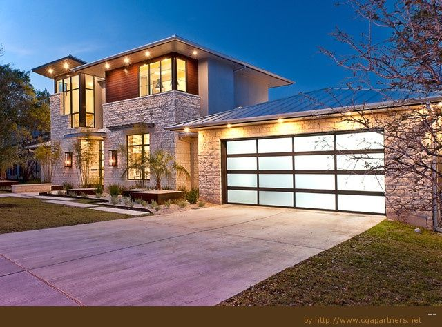 Contemporary aluminum and glass garage door glows at night like the look check out the clopay - Reasons inspect garage door ...