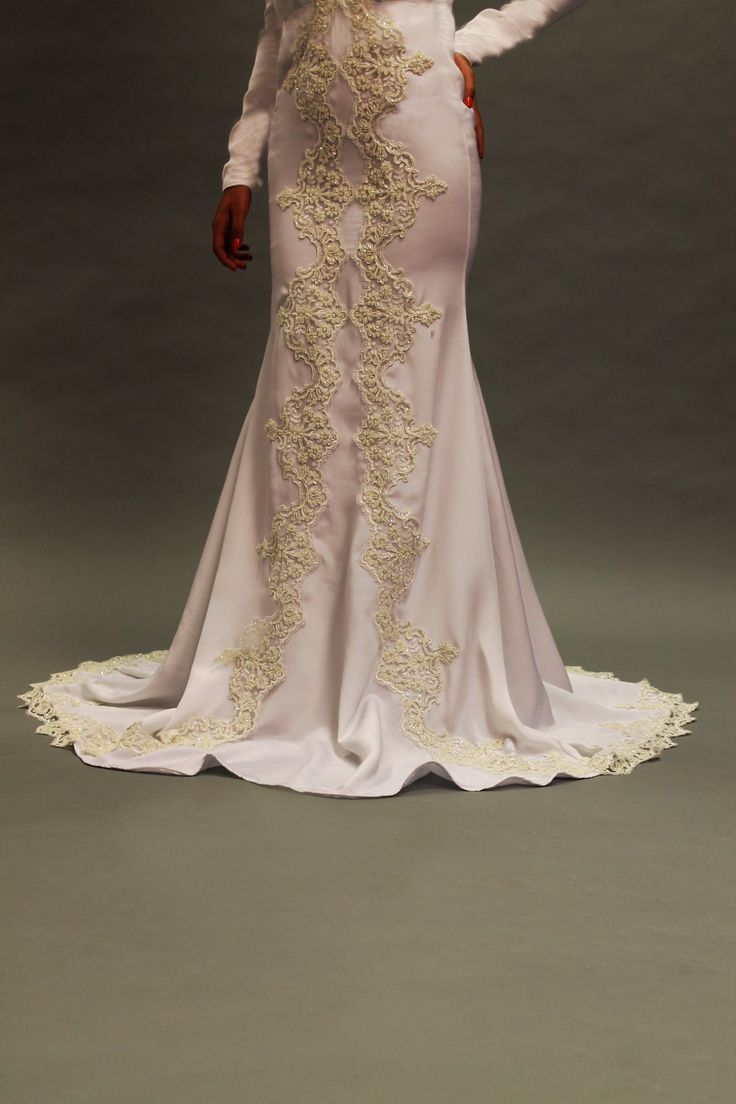 7m of beaded ivory lace was hand sewn to create this gorgeous effect #weddingdress
