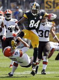 Pittsburgh Steelers Antonio Brown (84) kicks Cleveland Browns punter Spencer Lanning (5) as he jumps while returning a punt in the second quarter of the NFL football game on Sunday, Sept. 7, 2014, in Pittsburgh....love the browns but it was the funniest thing ever!