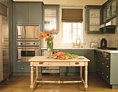 Darker colors can really open up a room in a smaller-sized kitchen. Try painting the cabinets a darker color, such as Benjamin Moore's Great Barrington Green