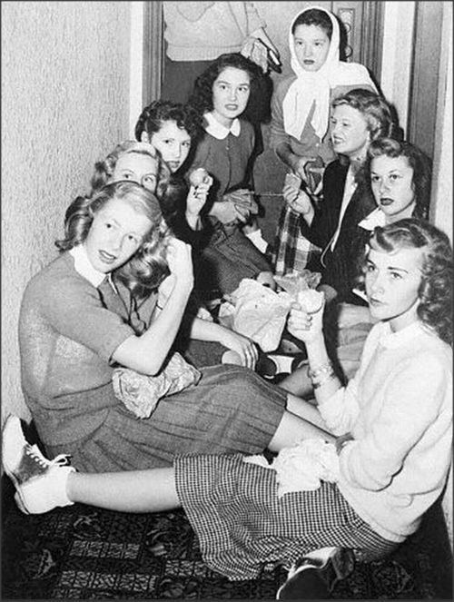 Bobby Soxers crowd in a hotel hallway waiting to catch a glimpse of Errol Flynn, 1945. Alameda, California. Tumblr