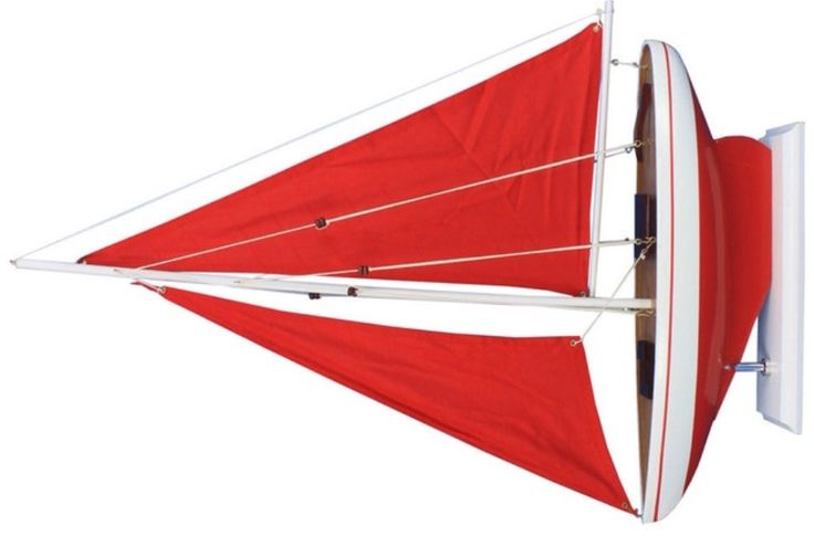 http://www.houzz.com/photos/13121470/Pacific-Sailer-Wood-Model-Boat-Red-and-Red-Sails-25-beach-style-decorative-objects-and-figurines