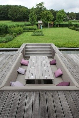 sunken in picnic table and booth style bench seating area for your back deck.