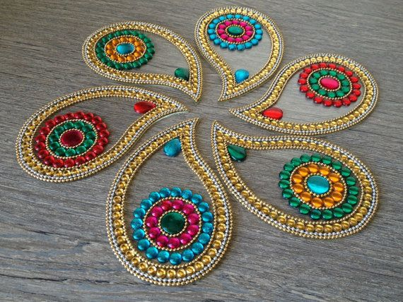 This is a beautiful Floor art from India made using Crystals on High quality Clear 2mm acrylic cut outs. I have kept the design basic, traditional and colorful. Perfect for Diwali -2015  Perfect as a wedding decoration to welcome guest. Also suitable for festivals and as decoration item as a table centerpiece for wedding or cosy candle-lit dinner. This is a modular rangoli which can be arranged in various ways as individual pieces or together both indoor and outdoor. The rangoli can be used…