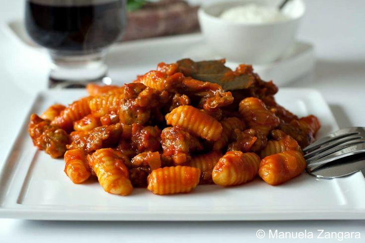 Malloreddus alla Campidanese - a classic Sardinian pasta recipe made with a sausage, tomato and saffron sauce.