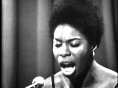 """Nina Simone does a riveting performance of """"Ballad of Hollis Brown"""" in Holland on 25 December 1965. This performance is verrrry different from the way Dylan does the song. He tells it objectively from a distance. Simone puts Brown at the very heart of her performance with her incessant piano riff, which stops only after the seven shots ring out. This is the only cover of a Dylan song that I like better than any Dylan version of the song. Text © 2013 by Ron Chester ALL RIGHTS RESERVED"""