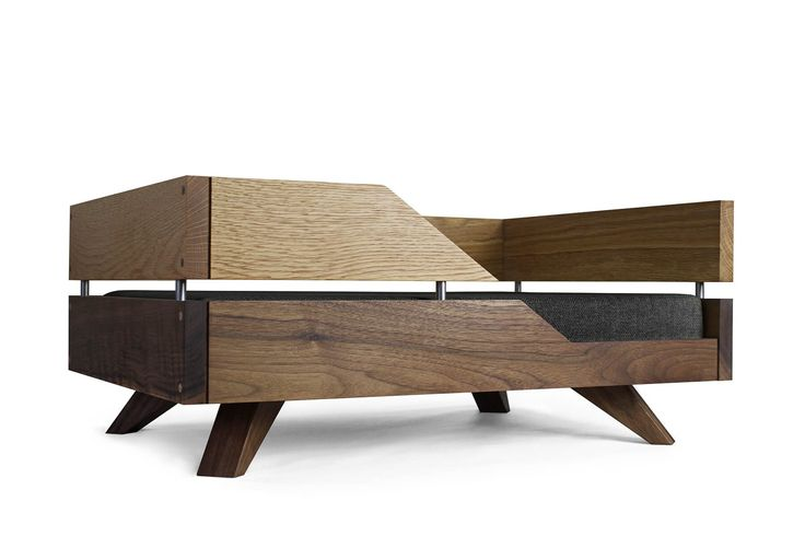 Contemporary wooden dog beds handmade from solid oak, walnut or a combination of both with a choice of cushion fabric. Free delivery to the UK & Ireland.