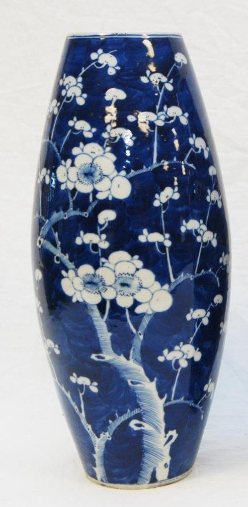 Chinese hand painted blue and white porcelain oval form vases depicting flowering branches.