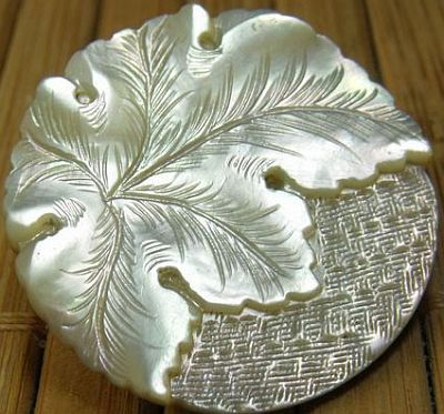 BEAUTIFUL ANTIQUE HAND CARVED MOTHER OF PEARL BUTTON.