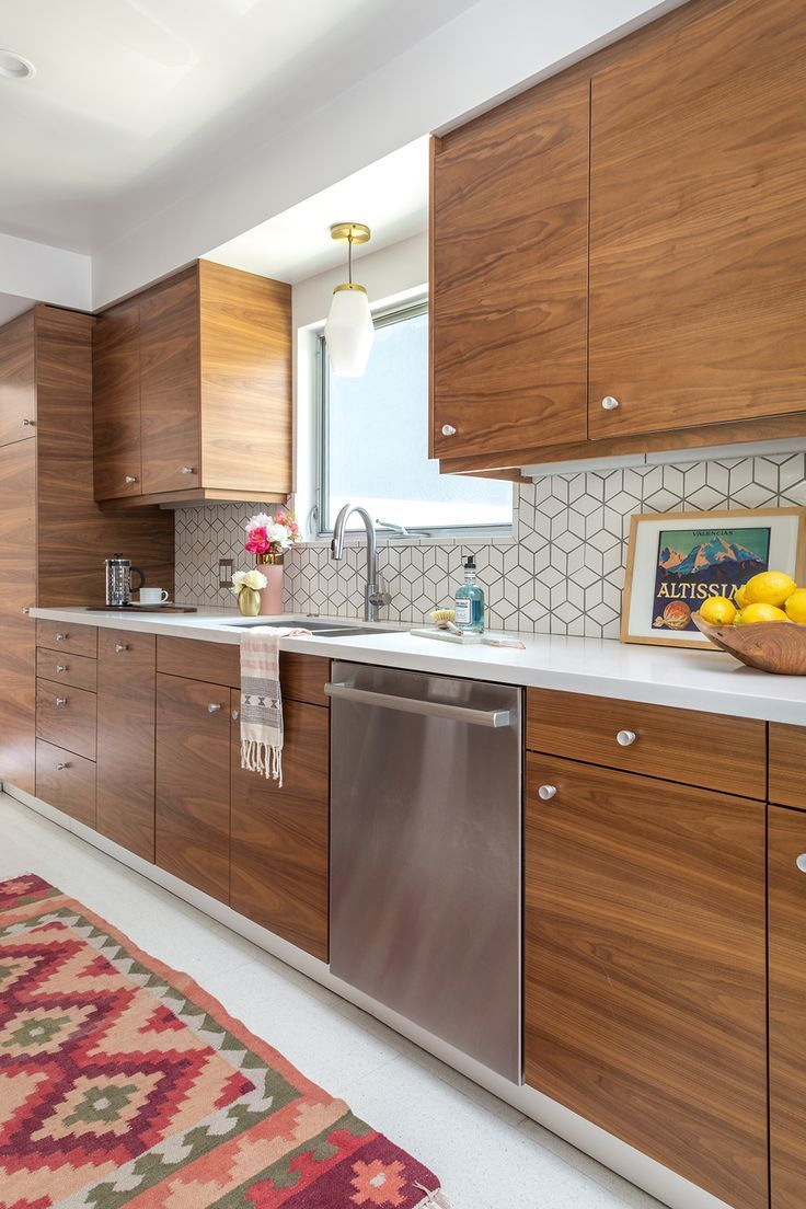 Check out this mid century modern kitchen renovation. A Vintage Splendor shares tips, sources, and information to get an updated kitchen. DIY Kitchen using IKEA boxes and Semihandmade fronts