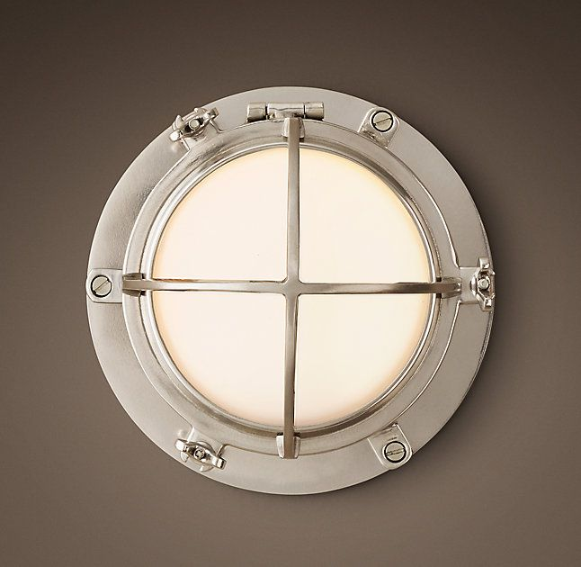 RH's 1920s Porthole Sconce:Replicating a turn-of-the-century naval design, when ocean liners were first illuminated with electric incandescent lamps, our fixture comes complete with the wingnuts required to protect against water and moisture on sea or on land.