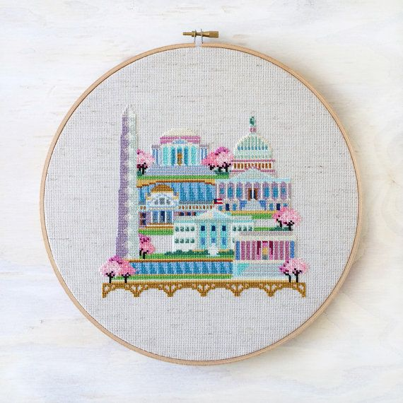 This modern cross stitch pattern of Washington DC features the White House, the U.S. Capitol, the Smithsonian Natural History Museum, the