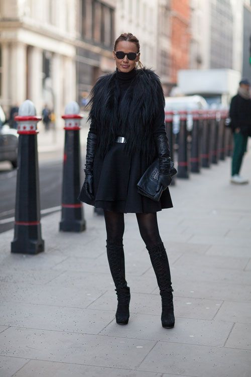Street Style : A metal bar belt made a splash on Dior's Spring runway and is having a superb life on the streets as well. {Read more: Dior Belted Dress and Coat - London Fashion Week Street Style - Harper's BAZAAR} Credit: Diego Zuko