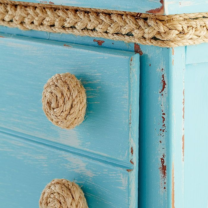 Put a new twist on old furniture. Apply braided rope to drawer knobs for an inexpensive, nautical look.