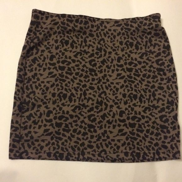 cheetah skirt  elastic band waist. materials are listed and shown in picture. perfect condition. Skirts Mini