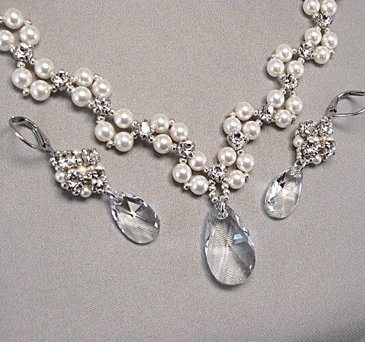 Necklace and Earring Set  Divinely feminine...our newest haute couture rhinestone/pearl necklace and earring set features a tantalizing fusion of