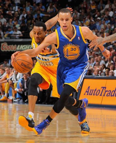 The Warriors' Stephen Curry, pursued by Andre Iguodala in the Quarterfinals of the 2013 NBA Playoffs