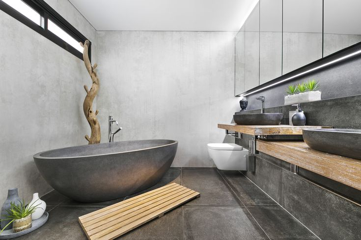 This bathroom has a great mixture of textures that really complement each other and allow them to stand out! Loving the fact the bath matches the floor tiles!