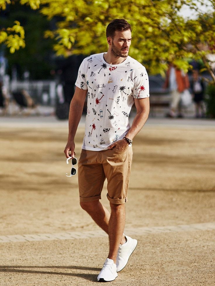 Very comfortable and casual summer styling from Bolf. The white cotton T-shirt is fantasticaly decorated by colourful prints. One more thing - camel shorts with a belt. The look is nicely enhanced by accessories - sunglasses and a leather bracelet.